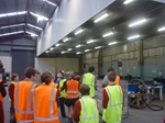 Students from James Hargest College listen as Angela from Southland disability Enterprises explains how they recycle TV's