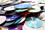 Pile of CDs, DVDs and BlueRay discs