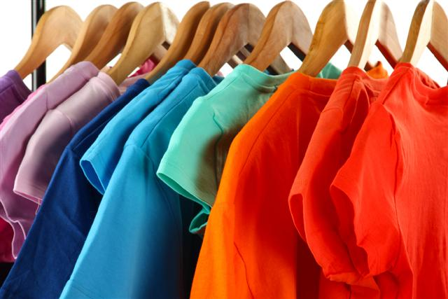 a rack of colourful clothing