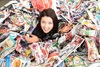 Rachelle Broere surrounded by the year's worth of junk mail delivered to her Invercargill mailbox