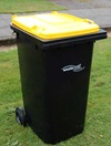 The new yellow recycling bin